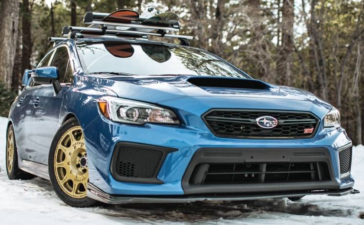Subaru STI on Method Racing Gold Rally Series Wheels